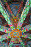 Ceiling in Wat Thawonwararam pagoda. Interior view of the colorful ceiling of the Wat Thawonwararam pagoda in Kanchanaburi, Thailand Royalty Free Stock Images