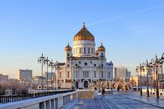 The decorated Patriarchal Bridge and the Cathedral of Christ the Savior in Moscow in January stock photo