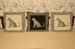 Decorative cushions. Decorated with pictures of a leopard in frame, here in a hotel in Pattaya, Thailand Royalty Free Stock Photos