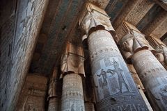 Decorated pillars and ceiling in Dendera temple, Egypt Stock Photo