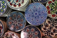 Decorated pot pads. Colorful Turkish ceramic pot pads stacked on display on Instanbul's Grand Bazaar stock photo