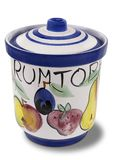 Decorated pottery Rumtopf pot with lid. Decorated hand painted pottery Rumtopf, or rum pot, with lid for a traditional Christmas German dessert over a white stock images