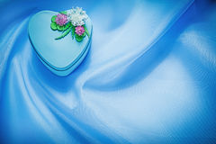 Decorated present box on blue fabric background holidays concept Royalty Free Stock Images
