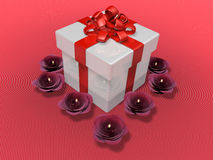 Decorated present box and flower candle Royalty Free Stock Photo