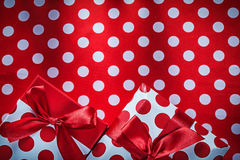Decorated presents on polka-dot red table cloth holidays concept Stock Photo
