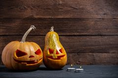 Decorated pumpkins for a Halloween on a mystical background. Two decorated pumpkins for a Halloween on a mystical background stock photo