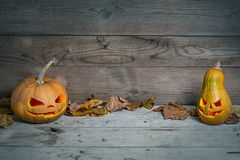 Decorated pumpkins for a Halloween on a mystical background. Two decorated pumpkins for a Halloween on a mystical background royalty free stock photos