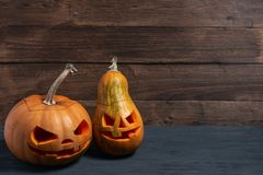 Decorated pumpkins on a mystical background. Two decorated pumpkins for a Halloween on a mystical background stock photos