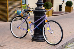 Decorated purple bicycle Stock Photos