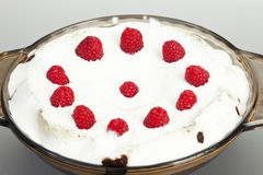 Decorated Raspberry and Cream Icing on a Chocolate. Cake in a Glass Pan stock photo