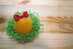 Decorated with red bow egg with space for text Stock Photo