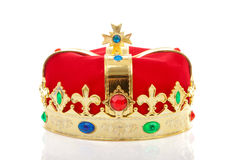 Decorated crown. Decorated red male crown over white background Royalty Free Stock Photo