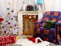 Decorated room for Christmas holidays. Beautiful holiday decorated room with Christmas tree and presents under it Stock Photos