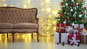 Decorated room with christmas tree, gifts and lights stock video footage