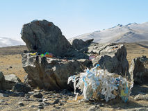 Decorated sacred place in Altai mountains, stone armchair. Stock Photos
