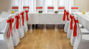 Decorated served party table at the cafe restaurant in red and white stock photo
