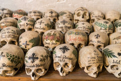 Decorated Skulls in a Bone House of Hallstatt, Austria Stock Photo