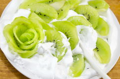 Decorated sliced kiwi with cream dessert Stock Image