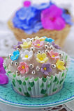 Decorated spring cupcake Stock Images