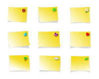 Decorated sticky notes. Blank yellow postit-like sticky notes you can write text into, with little illustrations on a corner to distinguish from each other Stock Photography