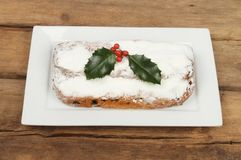 Stollen on wood. Decorated stollen on a plate on old weathered wood stock photography