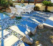 Decorated stone garden furniture table and chairs in the resort hotel stock image