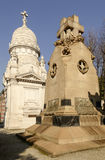 Decorated stone mausoleums at Monumental Cemetery, Milan. View of decorated stone mausoleums  at large monumental Cemetery in town, shot in bright late winter Royalty Free Stock Image