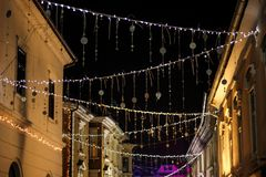 Decorated street with Christmas decorations in the night. royalty free stock photos