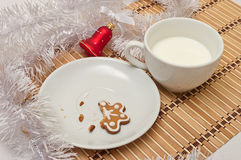 Decorated Sugar Cookies and Milk for Santa at Christmas Time on Royalty Free Stock Photos