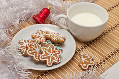 Decorated Sugar Cookies and Milk for Santa at Christmas Time on Royalty Free Stock Image