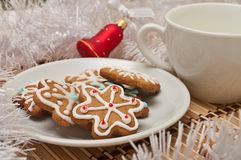 Decorated Sugar Cookies and Milk for Santa at Christmas Time on Royalty Free Stock Photography