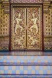 Decorated symmetric buddhist door. Stock Photo