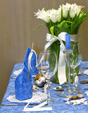 Decorated table. Table decorated with tulips bouquet and candles Royalty Free Stock Images