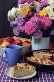 Decorated table with autumn bouquet  and pie Stock Photos