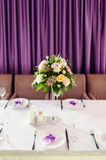 DECORATED TABLE WITH BEAUTIFUL FLOWERS IN THE ELEGANT RESTAURANT Royalty Free Stock Photo
