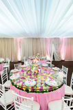 Decorated table with beautiful flowers in the elegant restaurant for the perfect wedding Stock Photography