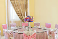 Decorated table with beautiful flowers in the elegant restaurant for the perfect wedding Royalty Free Stock Photos