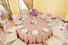 Decorated table with beautiful flowers in the elegant restaurant for the perfect wedding Royalty Free Stock Photography