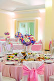 Decorated table with beautiful flowers and a lot of dishes in the restaurant Royalty Free Stock Photography