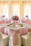 Decorated table with beautiful flowers and a lot of dishes in the restaurant Stock Image