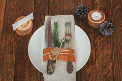 Decorated table for Christmas dining in rustic style Stock Photos