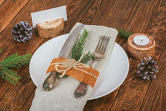 Decorated table for Christmas dining in rustic style Royalty Free Stock Photography