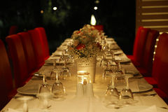 Decorated table for family and work  dinner. Decorated tables with plates and wine glasses for family and work  dinner Stock Image