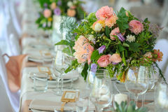 Decorated table, flowers. Bright and festive table decorated with delicate flowers Stock Image