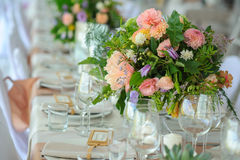 Decorated table, flowers. Bright and festive table decorated with delicate flowers Stock Photos