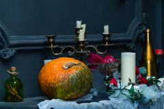 Decorated table with Halloween pumpkin jack and candleholder. De. Sign and concept of a holiday Halloween stock photo