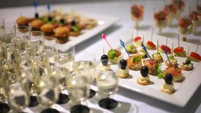 Catering. Decorated table, kanape salmon sprinkled with sesame seeds, stuffed with cheese. stock video footage