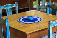 Decorated table outside for four. Decorated table in the brasilian restorant . the forniture of old wood painting in blue colors made romantic and exotic mood Royalty Free Stock Photo
