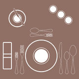 Decorated table with plate, knife and fork. Vector Stock Images