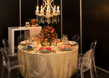 Decorated  table with plates and serviettes Royalty Free Stock Photo
